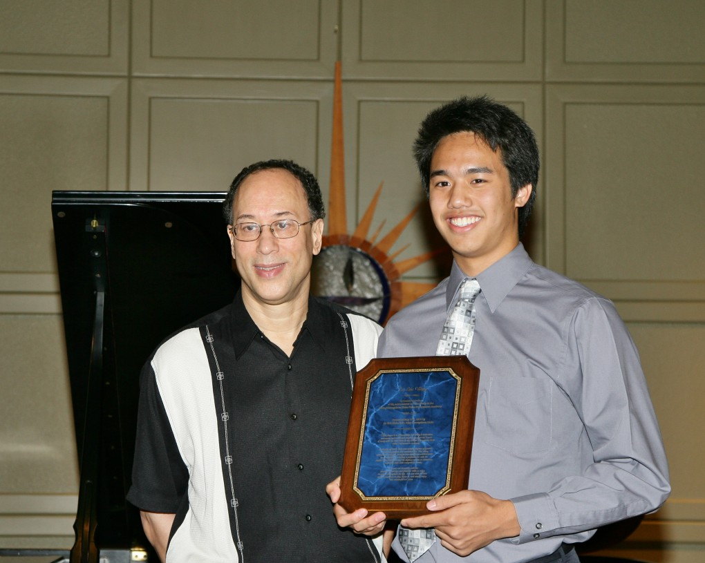 Eric Wang receives senior  yr. plaque